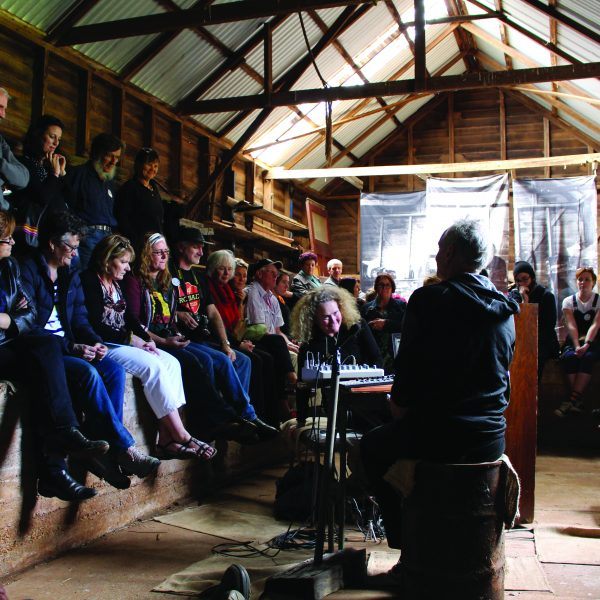 performance from the 2019 Ten Days' festival of our Acoustic Life of Sheds where a crowd watches on a performance within a barn setting