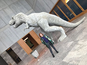 Lindy in front of a paper mache Tyrannosaurus Rex by Estonian artist Edith Karlson