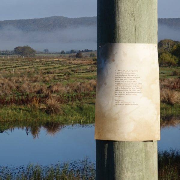 Piece of paper pinned to a telegraph pole for Julie Gough: Fugitive History